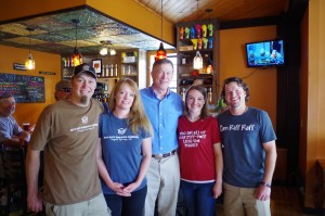 Governor Hickenlooper with the four founders, Randy and Eleanor Schnose on the left, Jason and Shelly Cox on the right.